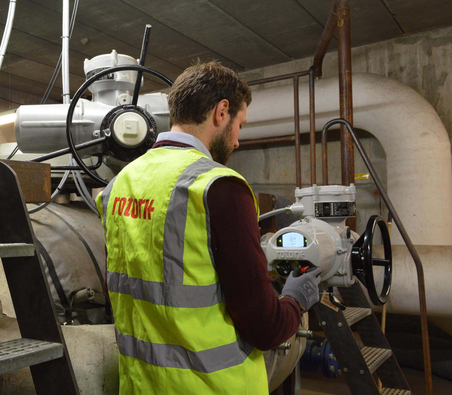 A Rotork engineer inspects one of the new IQ3 actuators installed in the underground valve chamber. The actuator in the background survived total immersion in near-boiling water
