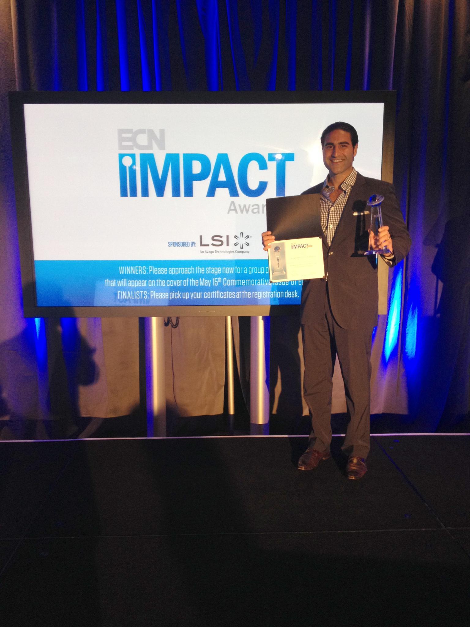 Alex Karapetian, Director of Sales and Marketing at Acopian Power Supplies, accepts the 2014 ECN Impact Award
