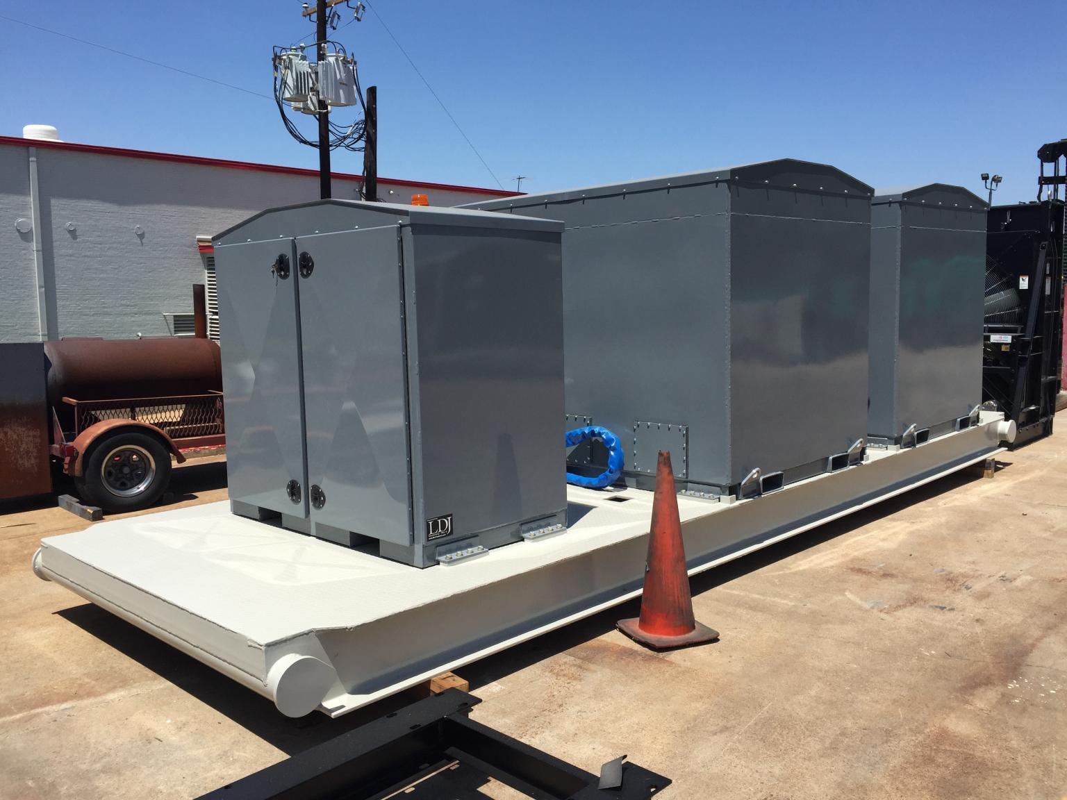 Skidded bulk DEF system that includes two 1,200 US gallon DEF tanks and one pumping cabinet