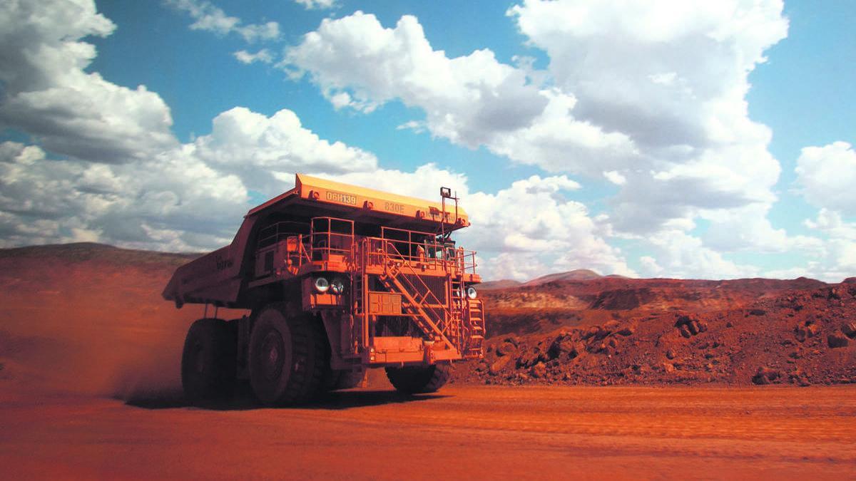 One of BHP Billiton's driverless Cat 793F haul trucks used in its Pilbara region iron ore mines