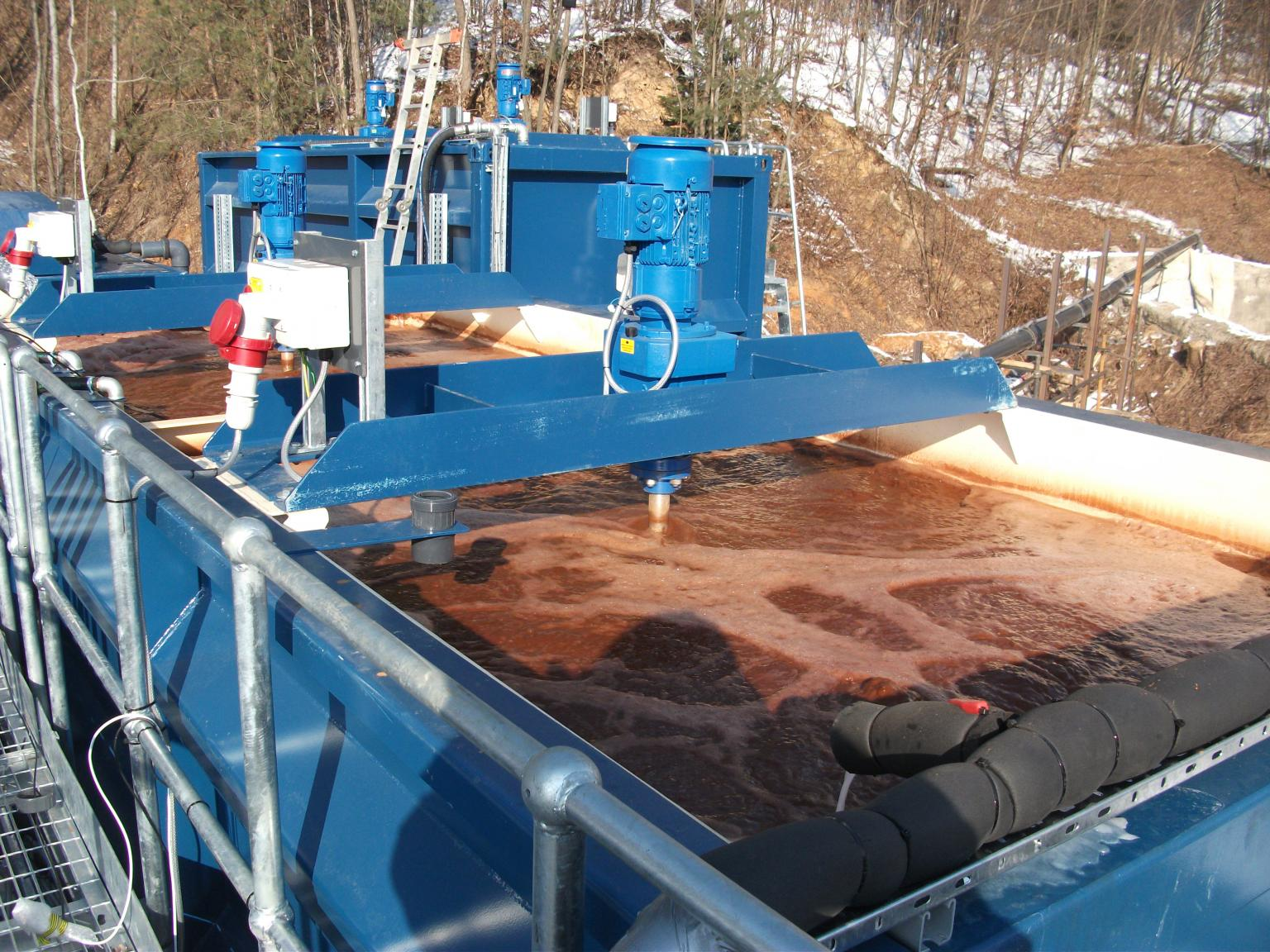 A two stage mixer tank with aeration to oxidise Iron and pH correction. Polymer is added at the outlet of the tank