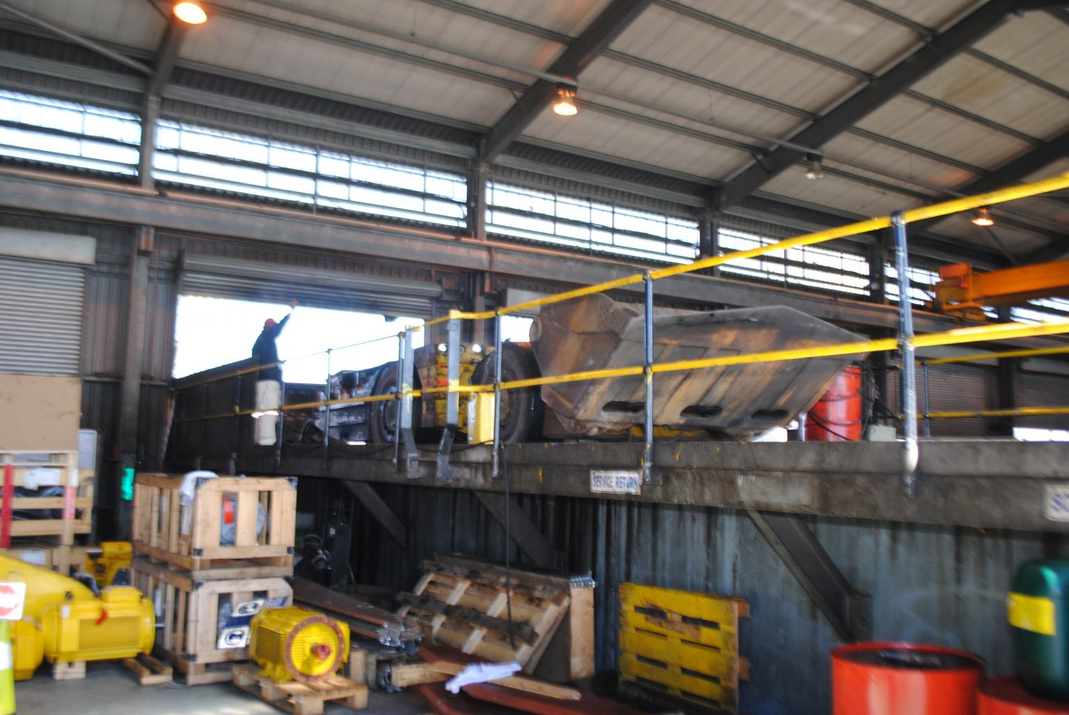 A ramp in Atlas Copco's surface workshop for Anglo American Platinum's Bathopele mine allows safe and easy access beneath Scooptrams to service components Photo: Author – M B Jones