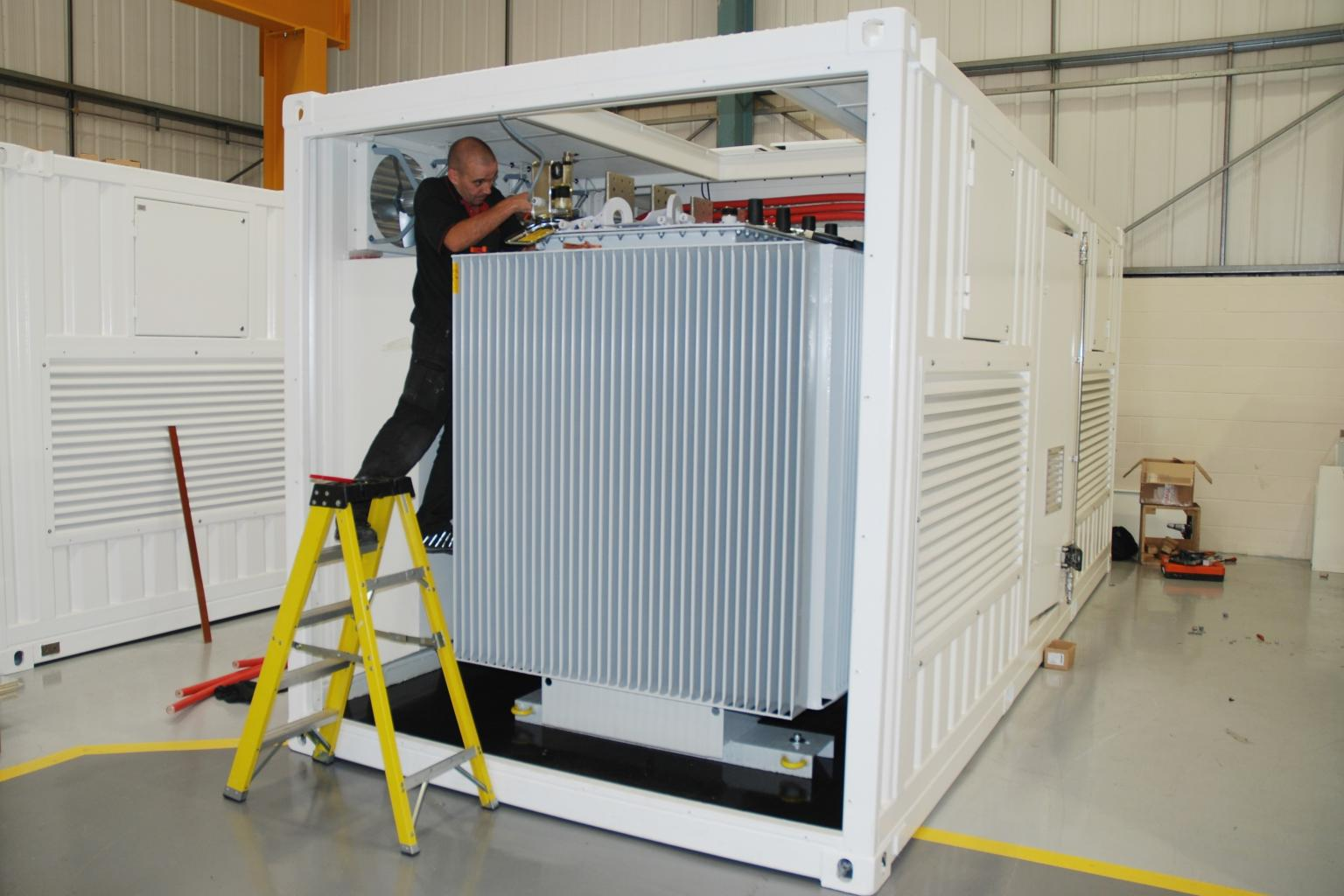 Inside the container sit various components such as the input isolators, cooling fans and extraction, voltage tap selection and medium/low voltage switchgear arrangement.