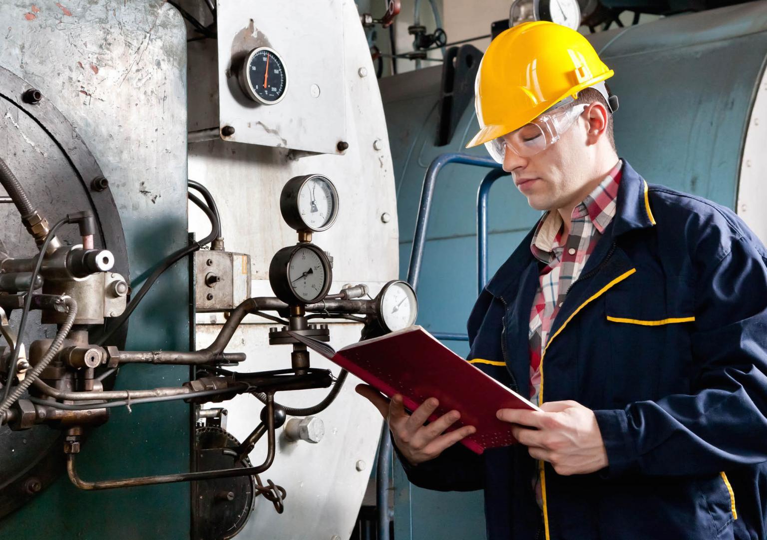 Worker maintaining machinery
