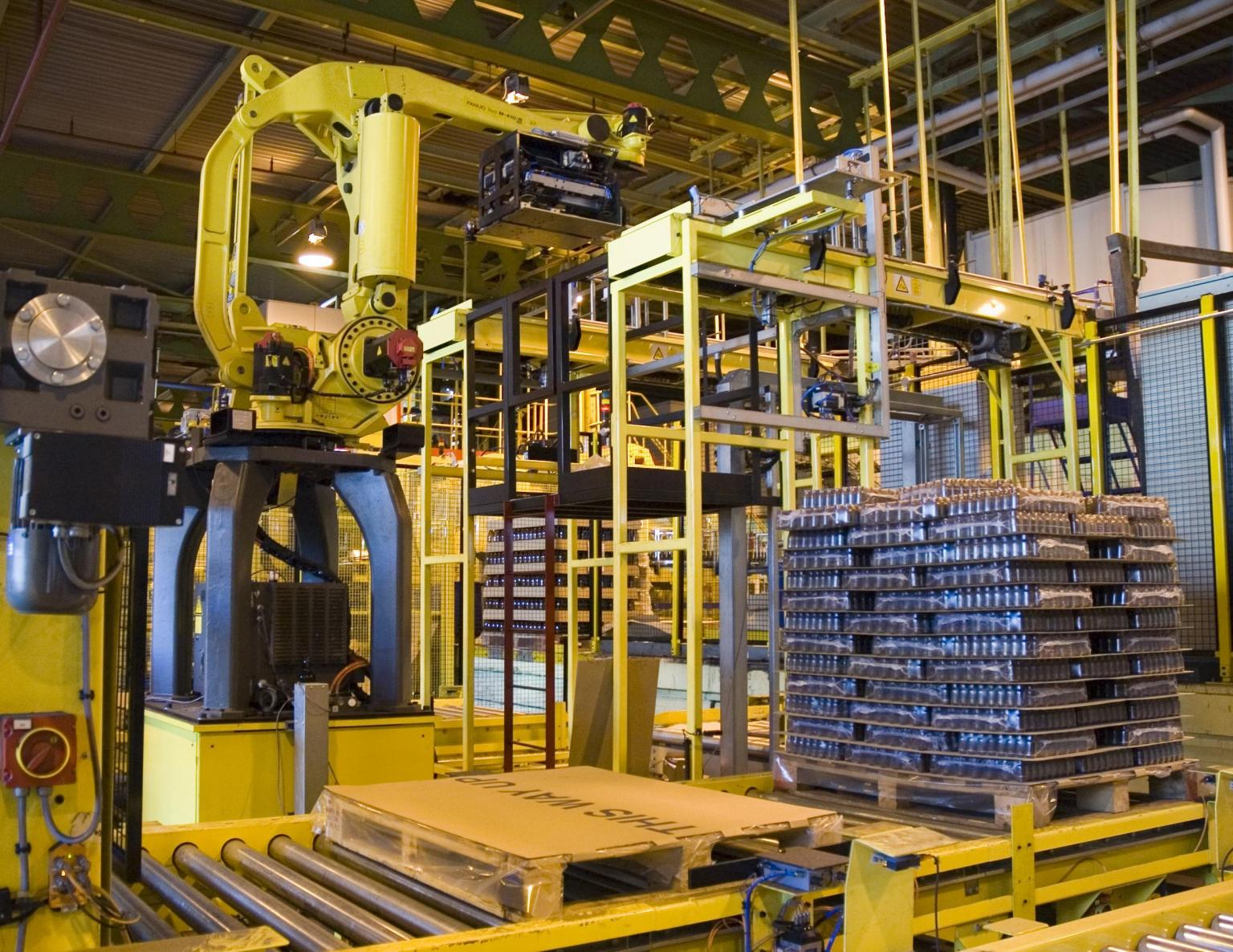 Fully automated palletising with two adjacent pallets allowing the robot to stack one while the full one is removed and replaced