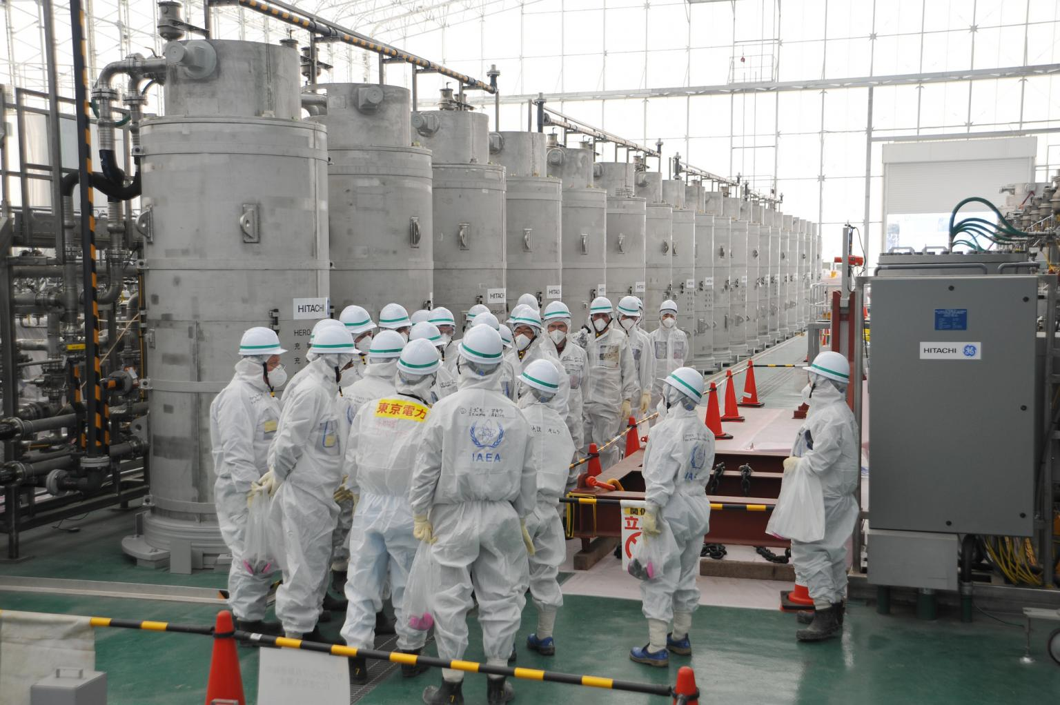 The IAEA mission team studies a water purification system that removes radioactive elements from water. Fukushima, Japan, 11 February 2015. Photo Credit: Susanna Loof/IAEA