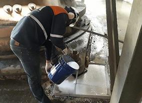 Slurry mix of Belzona 4111 being applied