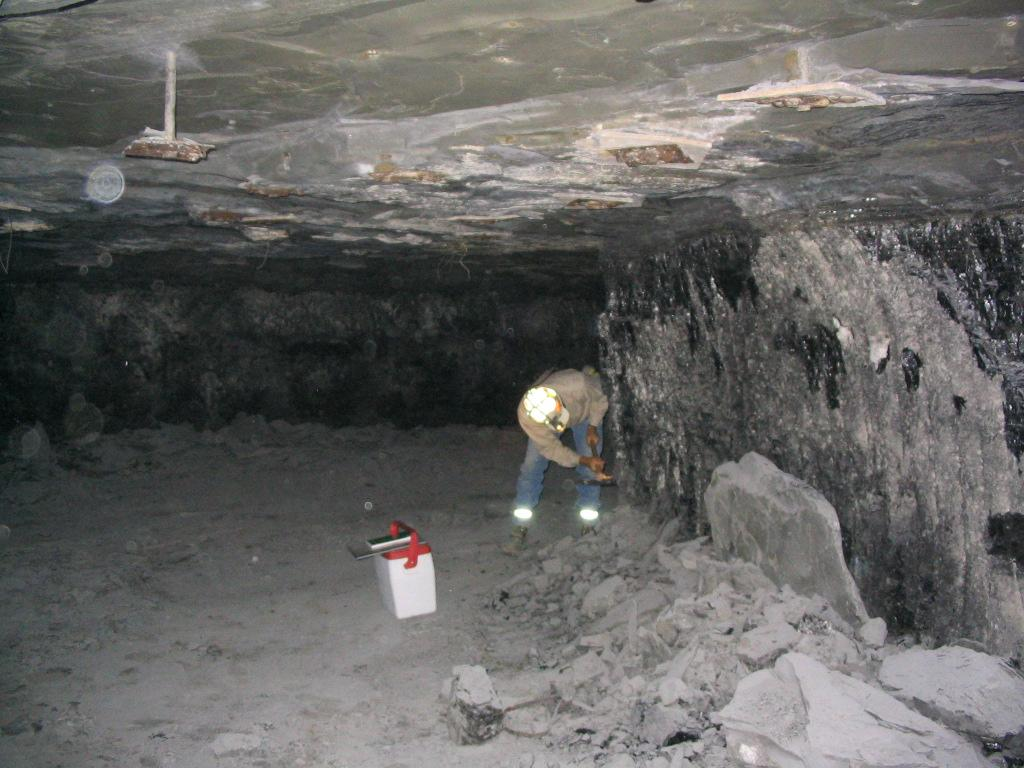 This shot of an underground pillar-and-stall colliery in Illinois shows white walls due to stone-dusting to cover and dilute possible explosive coal dust. Photo: Illinois State Geological Service - ISGS