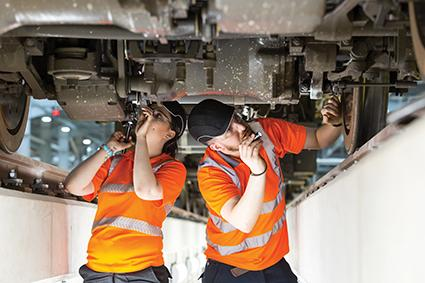 Bombardier engineers inspecting an undercarriage at London's Old Oak Common depot