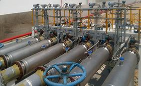 A bank of six DN400 straight tube Coriolis flowmeters with Entrained Gas Management installed in a refinery