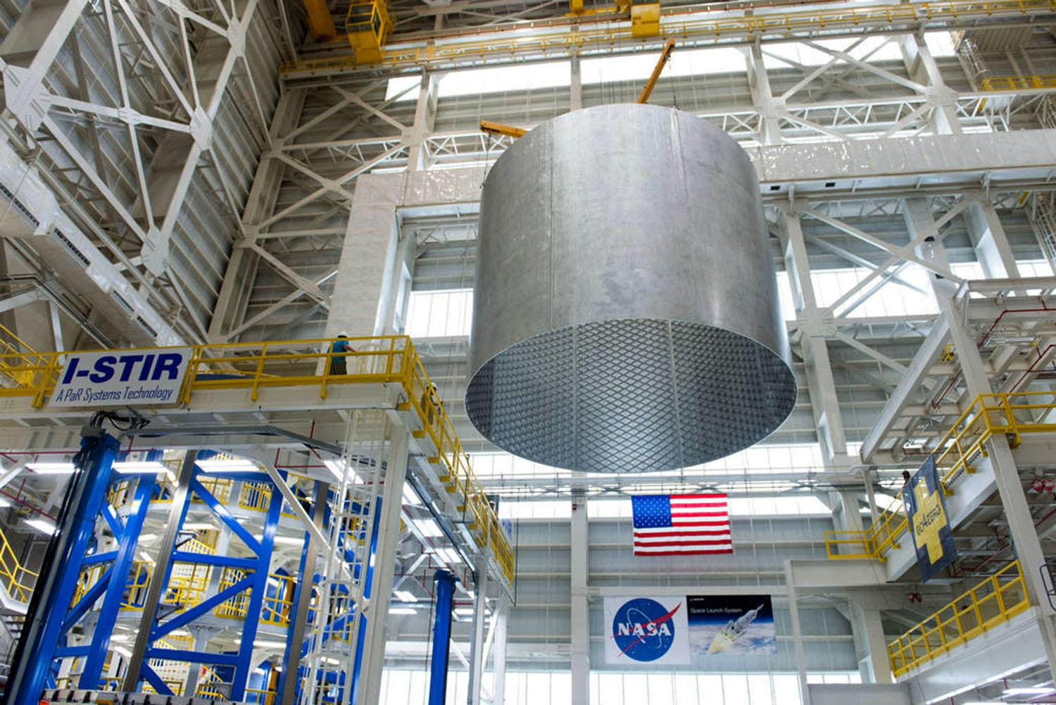 Welding large cylinders for space vehicles is done differently on the ground, photo shows Engineers at NASA's Michoud Assembly Facility transfer a 22-foot-tall barrel section of the SLS core stage from the Vertical Weld Center. The barrel section, above, will be used for the liquid hydrogen tank, which will help power the SLS rocket out of Earth's orbit. Image credit: NASA/Michoud