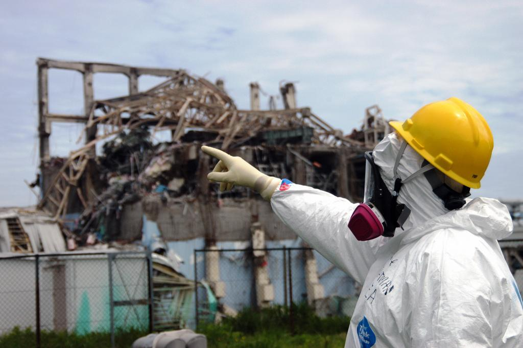 IAEA fact-finding team leader Mike Weightman examines Reactor Unit 3 at the Fukushima Daiichi Nuclear Power Plant on 27 May 2011 to assess tsunami damage and study nuclear safety lessons that could be learned from the accident. Photo Credit: Greg Webb/IAEA