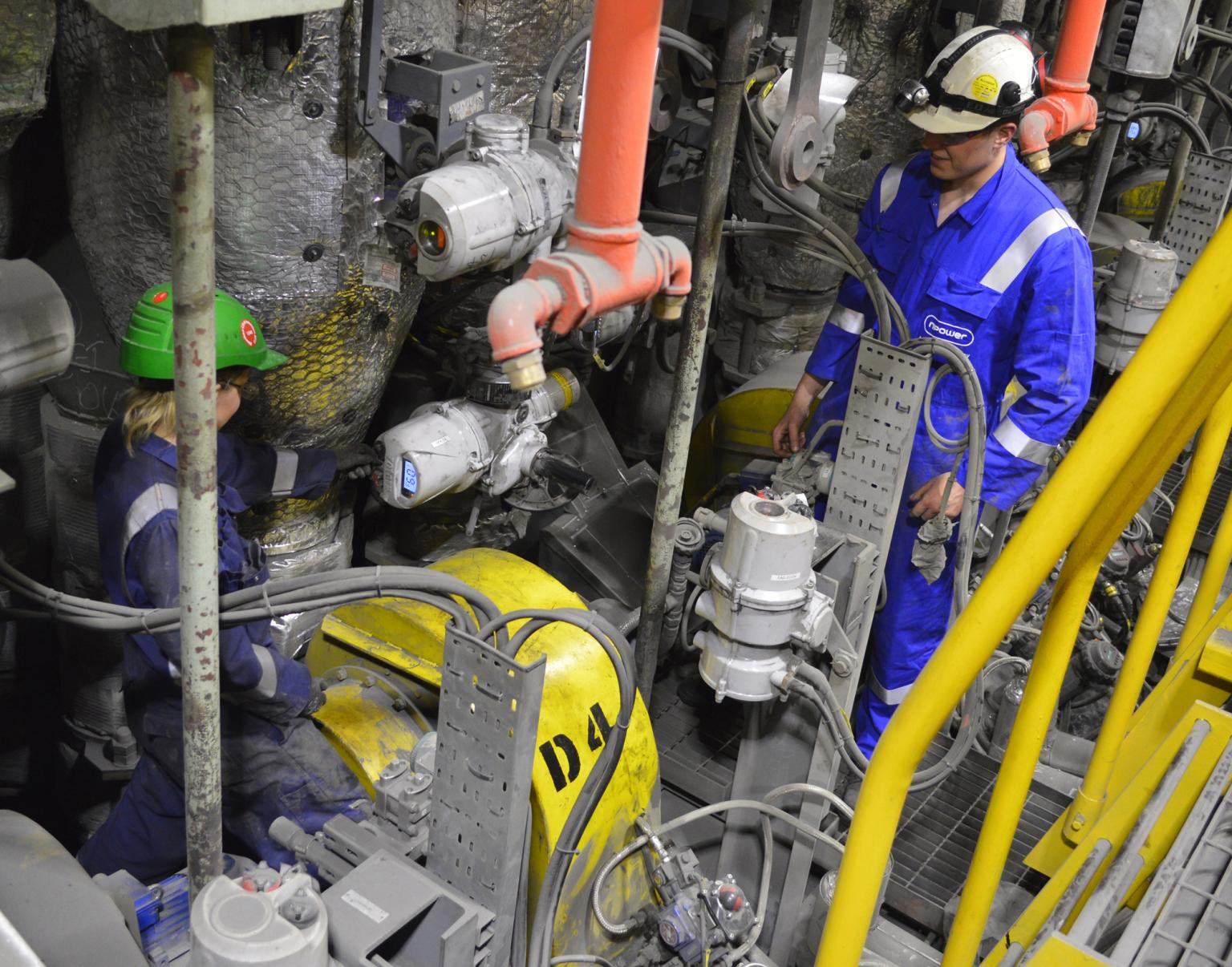 Electrical engineering staff at RWE Aberthaw Power Station inspect some of the Rotork IQ and IQT valve actuators installed on the Lo NOx plant