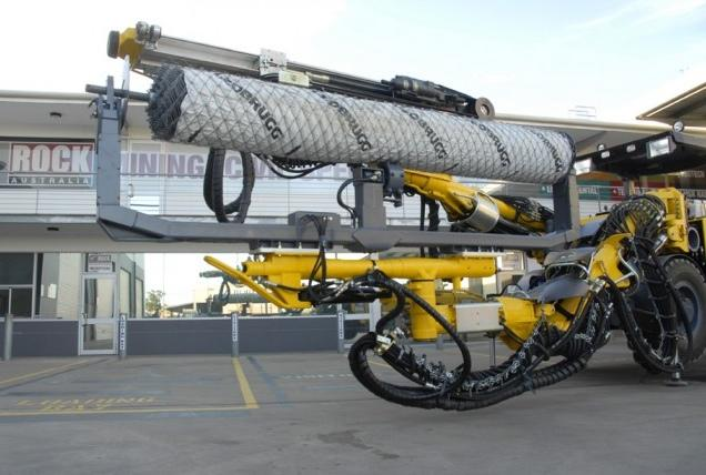 The Mesha handling system, developed by Rock Australia, can be mounted on any multiboom drill jumbo to install Geobrugg Tecco rolled steel-wire mesh without manual work at the site
