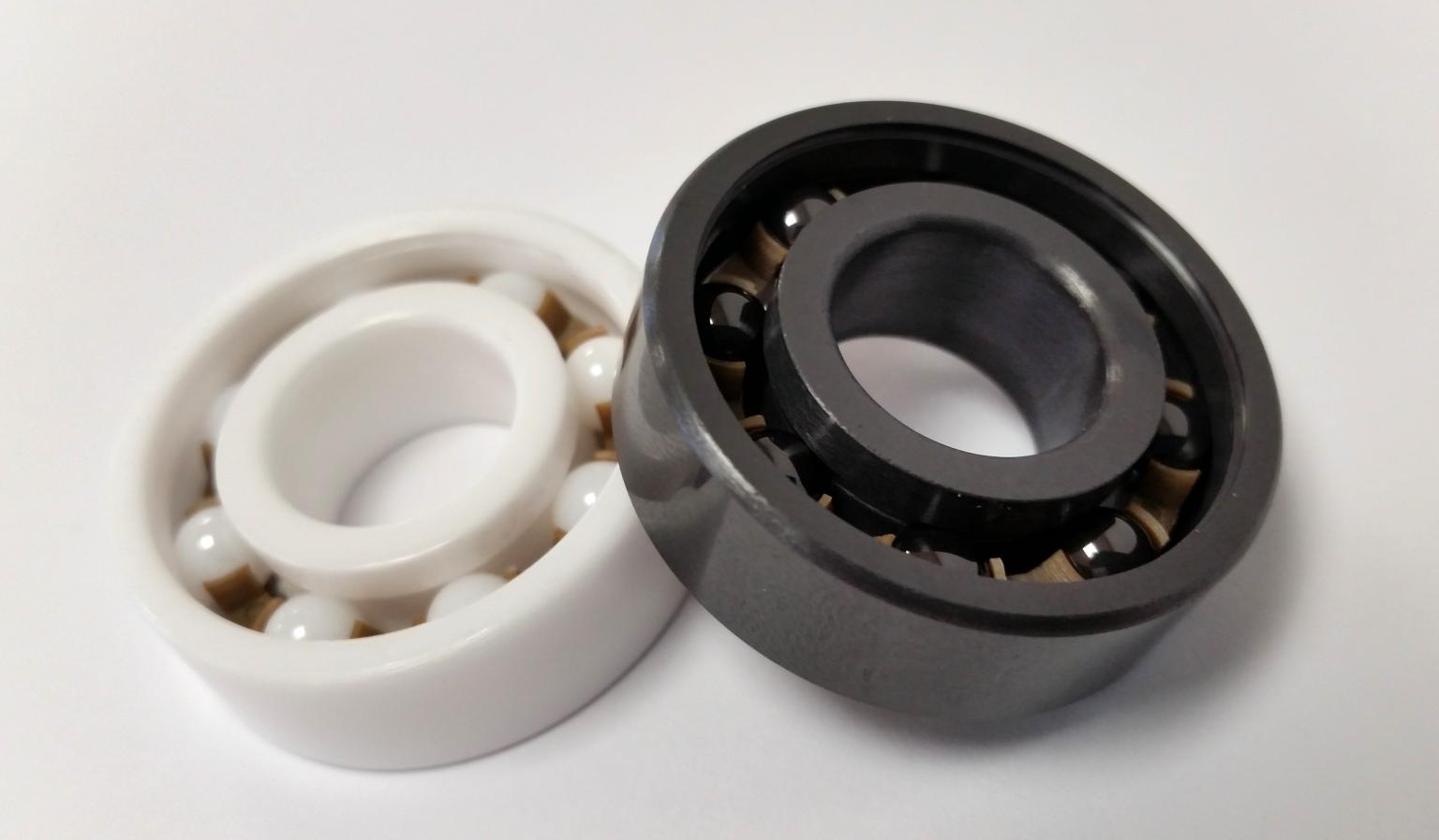 Full ceramic bearings made of zirconia (left) and silicon nitride (right)