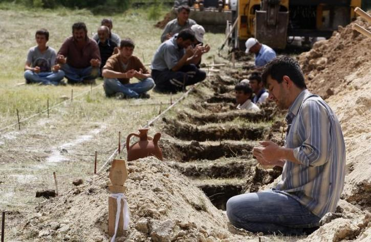 Empty graves await some of the 301 victims of the Soma, Turkey, mine disaster in May this year