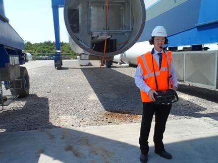 David Davies MP uses a special crane at Mabey Bridge's manufacturing facility