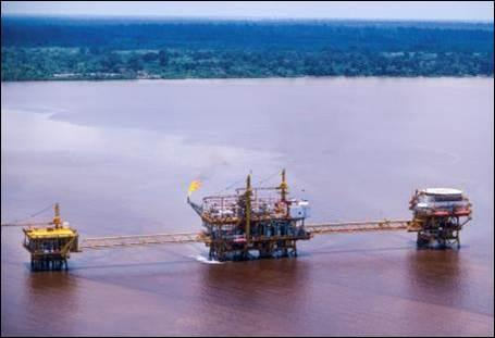 Oil platform in the hot, humid environment of a river mouth in Riau, Sumatra, Indonesia