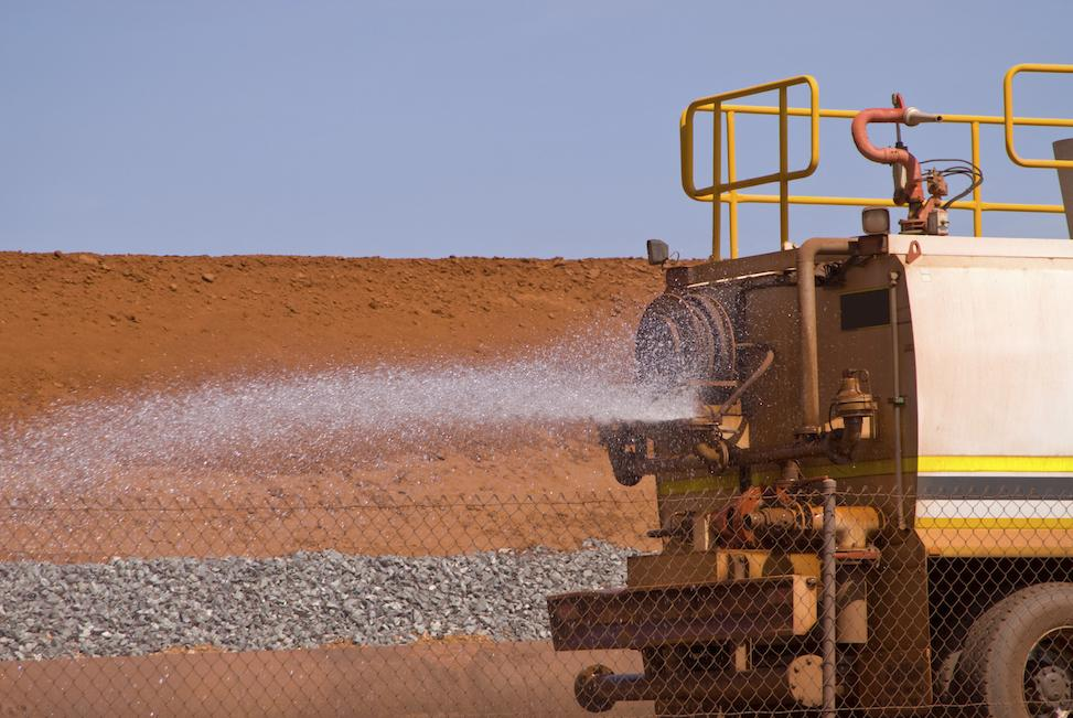 Water trucks are used to control dust at mining sites