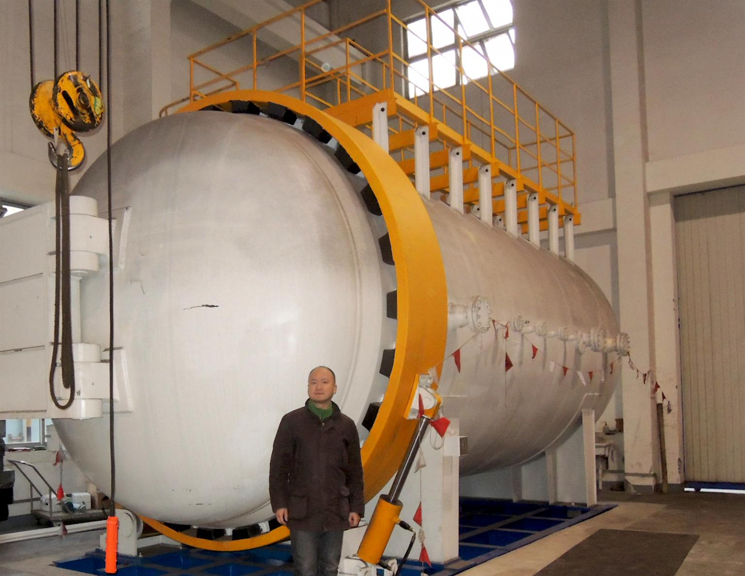 Zheng Zhang, Sales Manager for China, in front of the 80m3 testing tank into which the gas mixer feeds the Norm-defined gas mixtures. Image: Witt