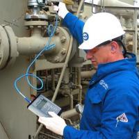 Quantification of through valve leakage using acoustic emission technology